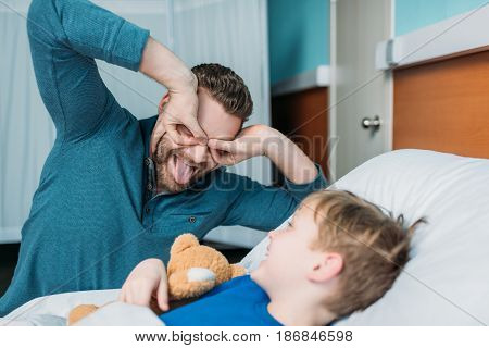 Grimace Dad And Son Having Fun In Hospital Chamber
