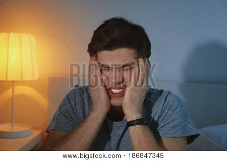 Young scared man after nightmare at home