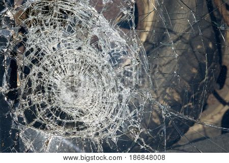 Broken windshield of a car in an accident. Damaged window.