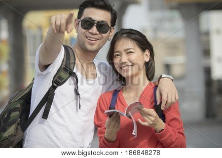 asian younger backpack man and woman happy traveling destination