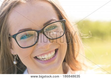 Woman smiling with perfect smile and white teeth in a park and