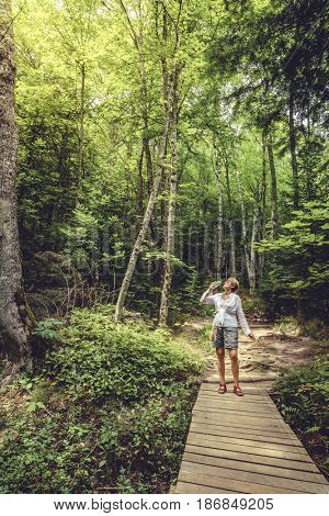 A woman on a trail in Pictured Rocks National Lakeshore, Michigan