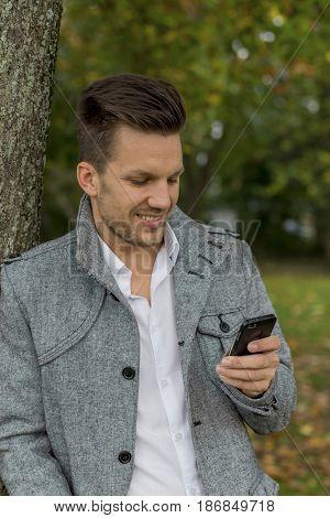 man writing sms