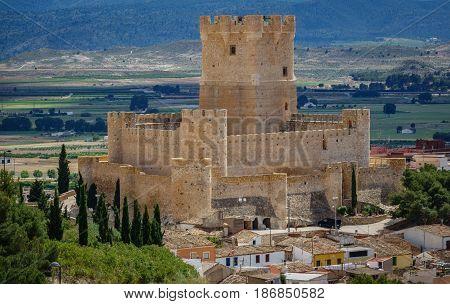 Long shot of Villena Castle against plain and mountain range. Villena is the part of Route of the Castles
