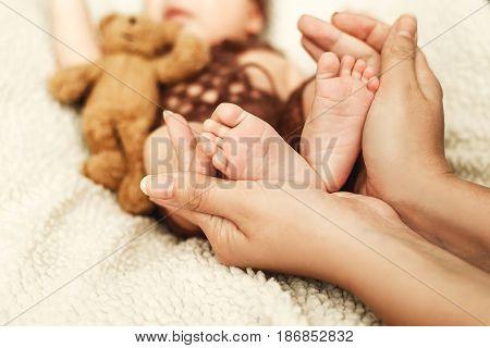 Baby legs. Legs newborn in parents hand