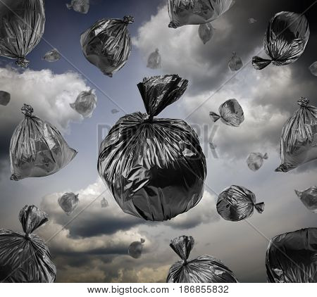 Black garbage bags in the stormy sky. Apocalypse and pollution concept. Environmental damage.