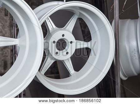 Powder coating and drying of tire in workshop