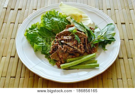 spicy chop pork and liver salad eat couple with fresh vegetable on plate