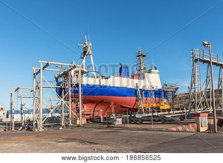 SALDANHA BAY SOUTH AFRICA - APRIL 1 2017: A fishing trawler being repaired on a slipway in Saldanha Bay an harbor town in the Western Cape Province