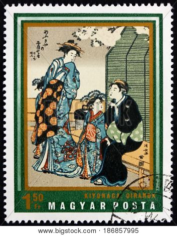 HUNGARY - CIRCA 1971: a stamp printed in Hungary shows Courtesans Painting by Kiyonaga Japanese Art circa 1971