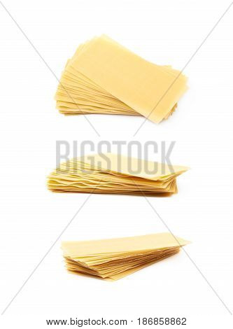 Twisted pile of dried lasagna pasta sheets isolated over the white background, set of three different foreshortenings
