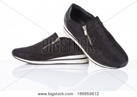 Black sneakers with rhinestones, isolated on white