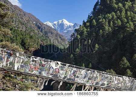 Suspension Bridge Over The Mountain Gorge In Sagarmatha National Park, Himalayas, Nepal. Nepalese Pr