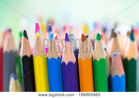 Closeup image of wooden color pencil in a colorful stack as education hobby artistic innovation office innovation and creativity collection supplies concept background