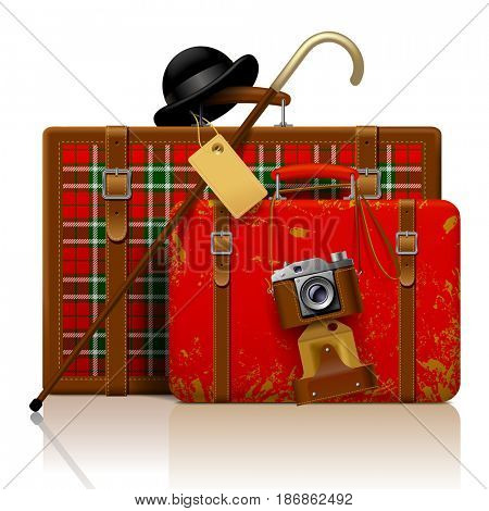 Red old suitcases with walking stick, bowler hat and retro photo camera isolated on white.  Vintage voyage and traveling accessories. Contains the Clipping Path