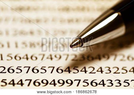 Number pen focus data finance reviewing financial figures