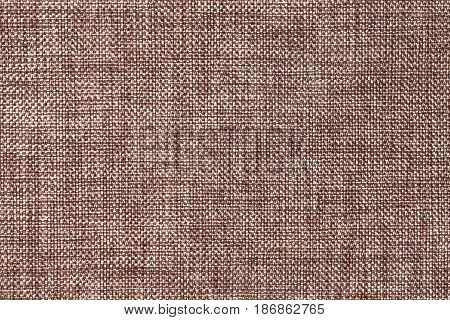 Dark brown and white background of dense woven bagging fabric closeup. Structure of the umber cloth with natural texture. Cloth backdrop.