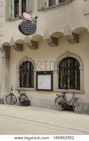 GRAZ, AUSTRIA - MARCH 20, 2017: White and black bicycles parked at a central street of Graz the capital of federal state of Styria Austria.