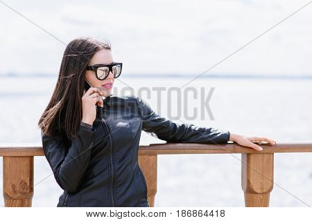 The Girl Is Talking On The Phone