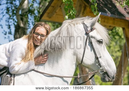 Close-up Portrait Of Teenage Girl And Horse