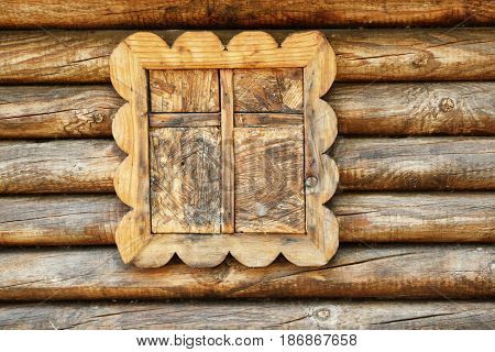 Wooden window in small hut