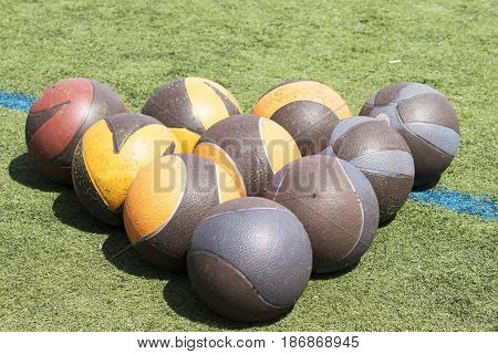 Medicine balls in the form of a triangle on a green turf filed