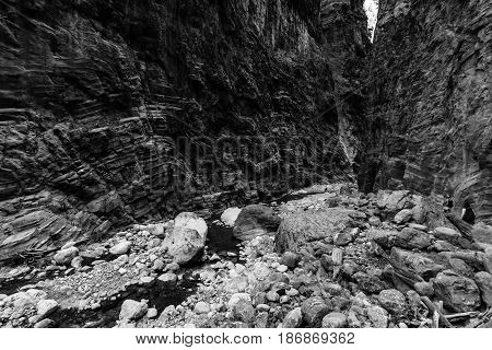Samaria Gorge. The bed of a mountain river. Crete. Greece. Black and white. Stylization.
