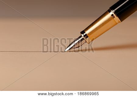 Fountain pen writing utensil writing instrument close up nib focus on foreground line