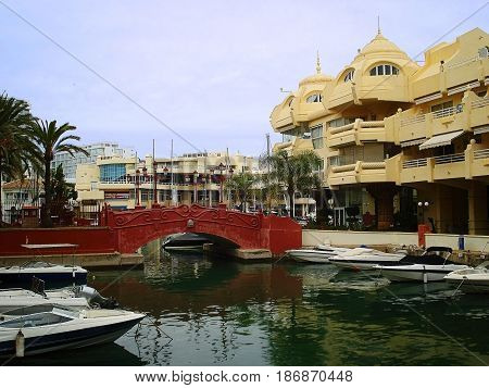 Puerto Marina is а real mini-city with houses on artificial islands. Apartments in such houses cost very much. It is possible to reach these houses either by the boat or sometimes by bridge. On the photo the red bridge to one of houses and boats at moorin