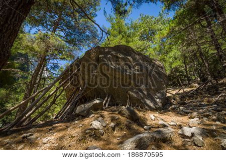 Samaria Gorge. Tourist tradition - to set the sham wooden stop under a large stone. Island of Crete Greece.