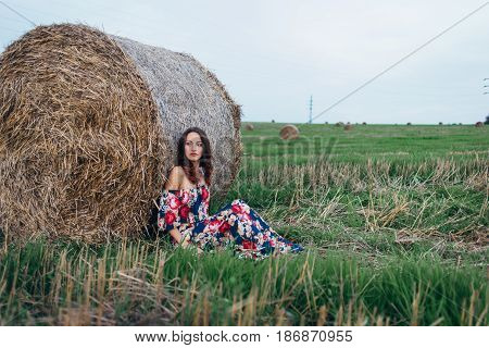 Photoshoot of a girl in a dress in summer stacks