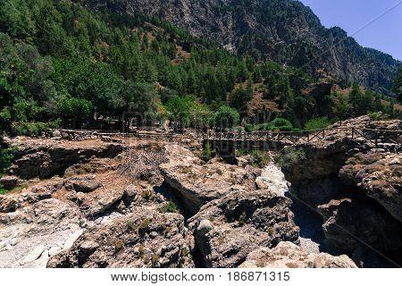 Samaria Gorge. The ruins of an abandoned village. Island of Crete. Greece. Stylization. Toning.