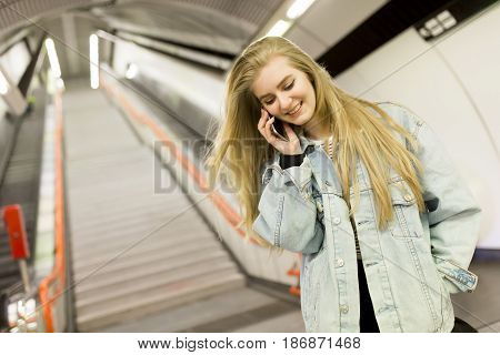 Young Woman Standing On A Subway Station