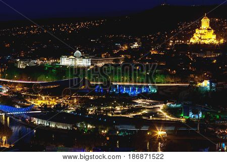 Night panorama view of Tbilisi capital of Georgia country. The Holy Trinity Cathedral of Tbilisi (commonly known as Sameba) and Presidential Administration of Georgia.