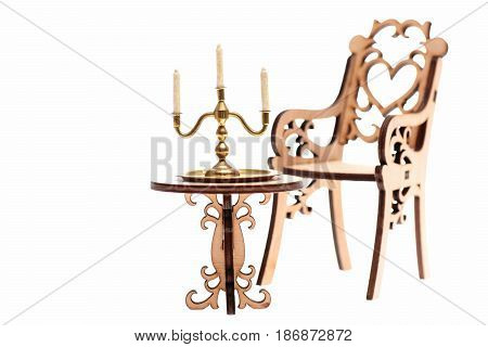 Decorative Wooden Chair With Golden Candlestick On Table