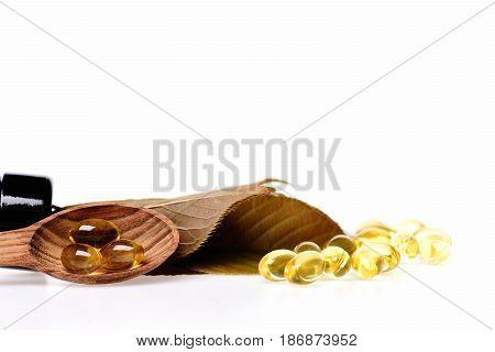 Fish Oil In Omega Capsule In Wooden Spoon