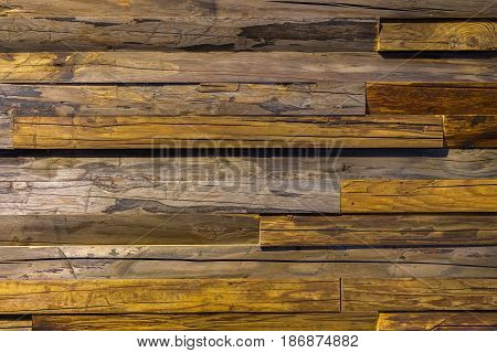 Close-up brown vintage natural wooden planks. Dark aged empty rustik pattern texture. For natural design, patterns, decoration