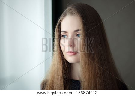 Young Dreamy Woman Near Window At Home, Closeup Up Natural Light Portrait