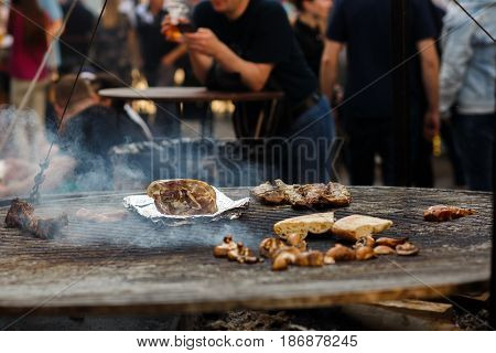 Meat Ribs Beef Mushrooms Grilling On Open Grill, Outdoor Kitchen. Food Festival In City. Tasty Food