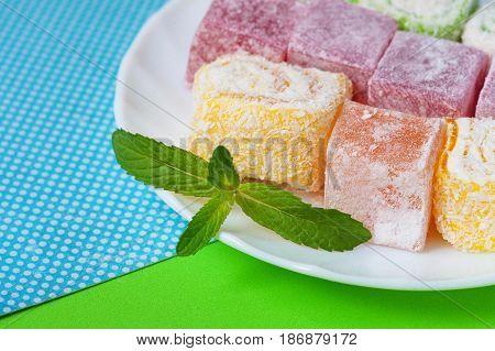 Rahat-lokum Sweet Turkish delight lokum traditional dessert on white plate