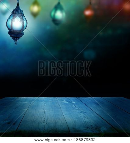 Ramadan Kareem background.Ramadan lantern and wooden  table