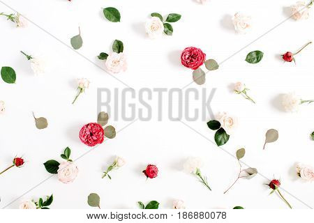 Round frame wreath pattern with red and beige rose flower buds branches and leaves isolated on white background. Flat lay top view. Floral background