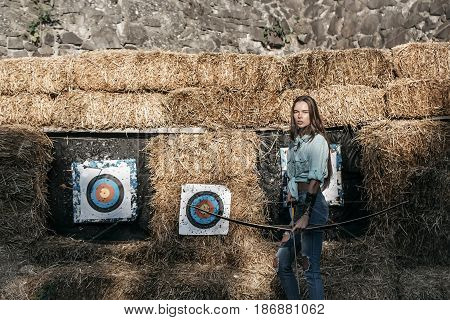 Cute Girl Archer Holding Bow And Arrow At Archery Targets