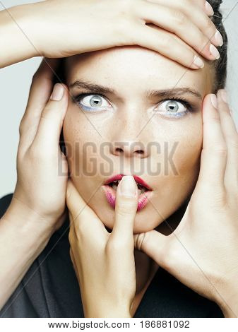 Surprised Face Of Woman With Makeup And Hands On Head