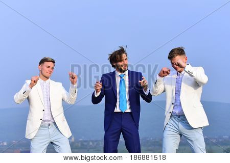Man And Twins Guys Dancing On Blue Sky, Corporate Party