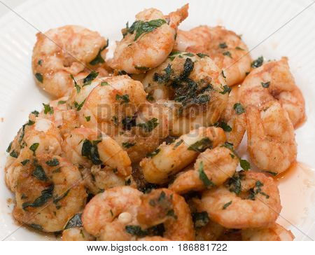 Closeup detail of fresh and healthy seafood salad with shrimps isolated on white