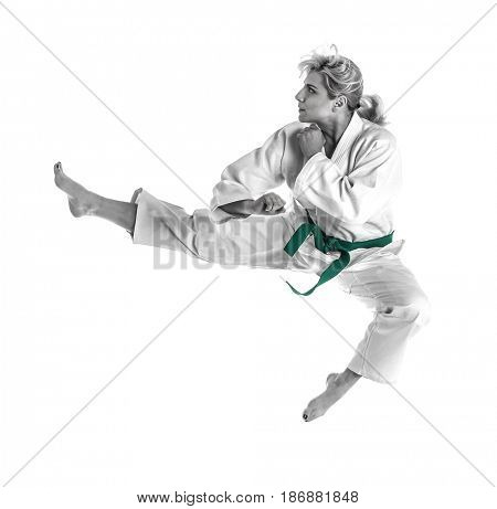 Martial arts concept. Young sporty woman in kimono on white background
