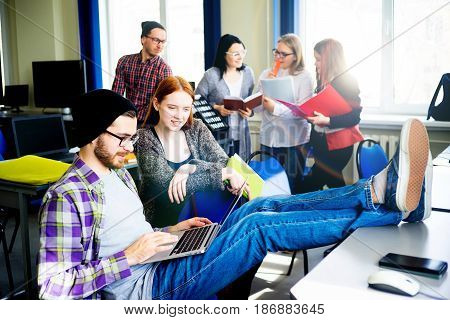 Portrait of a male student using a computer in IT class