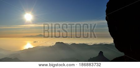 Panoramic view at sunset, summit of Gran canaria with the Roque Bentayga  and Tenerife island in the distance, Canary islands