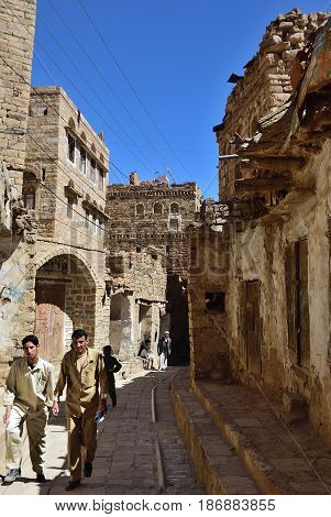 Thula Yemen - MAR 14 2010: People on the street in medieval of Thula. Thula is a UNESCO World Heritage City now destroyed by the civil war